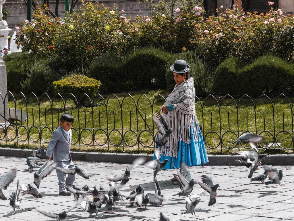 La Paz Bolivia grandmother and grandson playing birds
