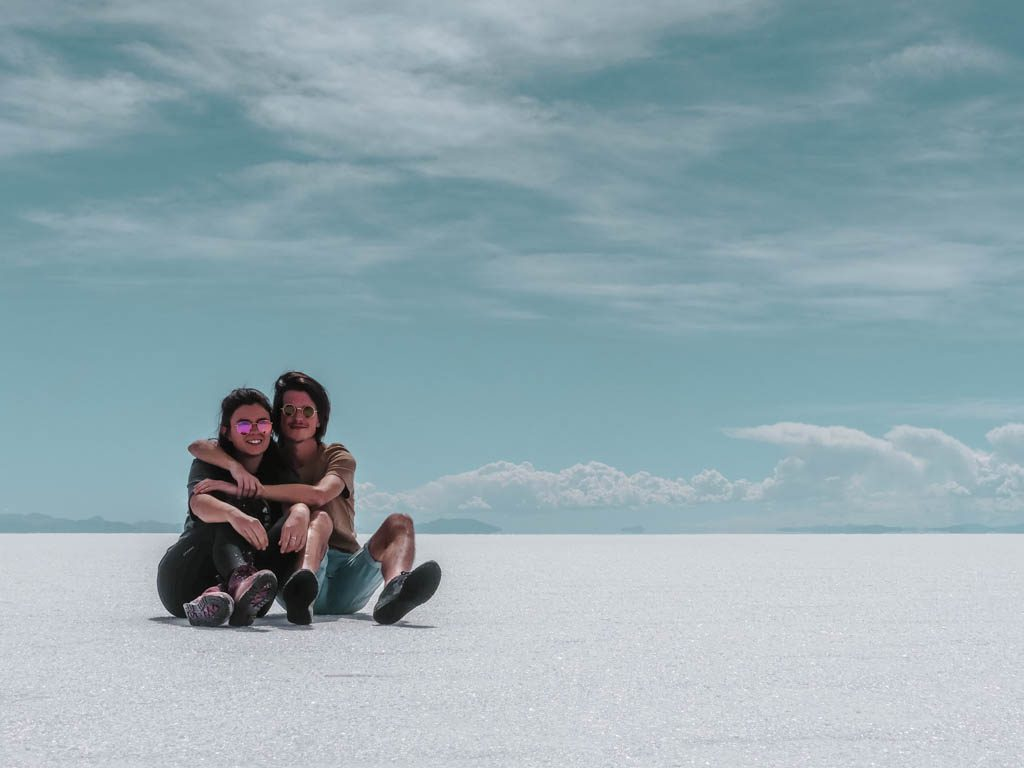 Salar de Uyuni Salt Desert Couple sitting in the salt selfie