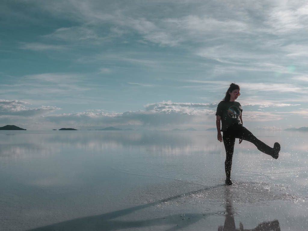 Salar de Uyuni Girl walking on water salt desert